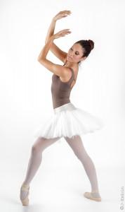 young and beautiful ballet dancer posing in studio